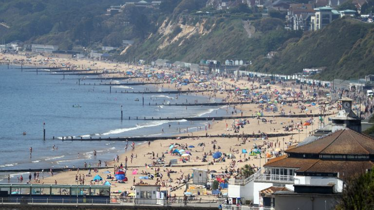 Photo of Coast roads 'gridlocked' as thousands flock to beaches to enjoy year's hottest day