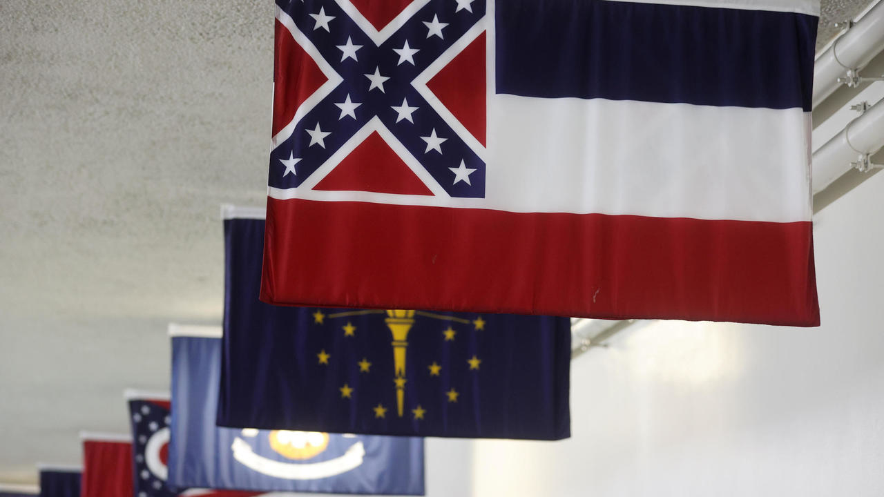 Photo of Mississippi governor signs historic bill removing Confederate symbol from flag