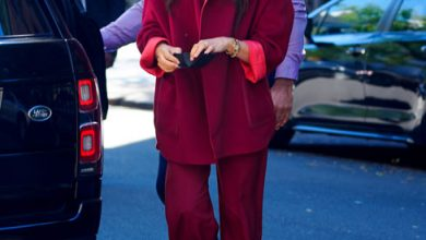 Photo of Meghan Markle 'stuns' fans in red trouser suit on New York school visit – 'looks so good!'